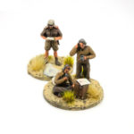 DG06 – Officer standing reading and two radio men